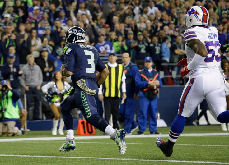 Monday Night Football: Bills vs. Seahawks:   November 7, 2016  - 31-25, Seahawks  -    Seattle Seahawks quarterback Russell Wilson (3) gets past Buffalo Bills \inside linebacker Zach Brown, right, to score a touchdown in the first half of an NFL football game, Monday, Nov. 7, 2016, in Seattle.