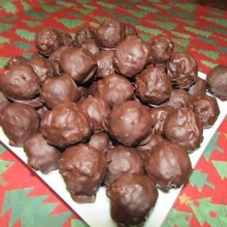 Chocolate Rice Krispie Balls ... ½ cup peanut butter  3 tbsps soft butter  1 tsp vanilla  1 cup Rice Krispies  ½ cup chopped pecans  1 cup shredded coconut  Directions :  Mix together,refrigerate for a half hour or longer and then form into balls. Return to fridge and let chill at least an hour.  Melt the following together in a double –boiler:  1 package chocolate chips,  1 square sweet chocolate  Keep on low so that chocolate remains soft.