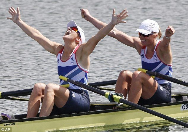 Hands up who won: Katherine Grainger and Anna Watkins celebrate their gold medal