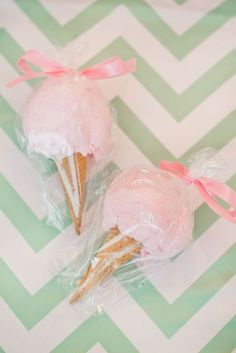 Ice cream cones filled with cotton cotton tied up with pink ribbon are sweet 1st birthday party favors. See more first girl birthday party ideas at www.one-stop-party-ideas.com