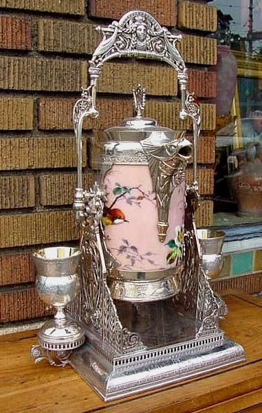 Victorian period silverplate tilting ice-water pitcher with matching goblets. Great medallion design at the top!