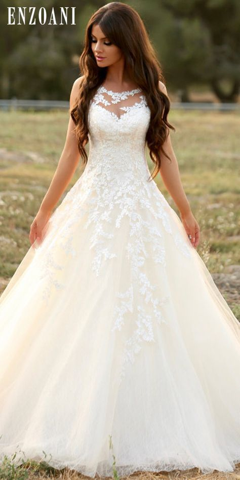 This gown by Enzoani is dripping with elegant fairytale vibes! Photo: Jay Jay Pr...