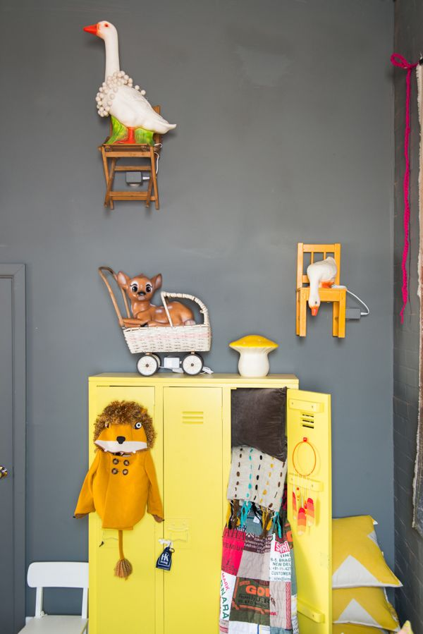 chairs on wall as shelves, quirky large plastic animals, yellow lockers - cool!