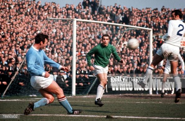 4th April 1969, Maine Road, Manchester, Manchester City v Leicester City, Manchester City's Glynn Pardoe crosses the ball, as Leicesters goalkeeper Peter Shilton and defender Peter Rodrigues defend