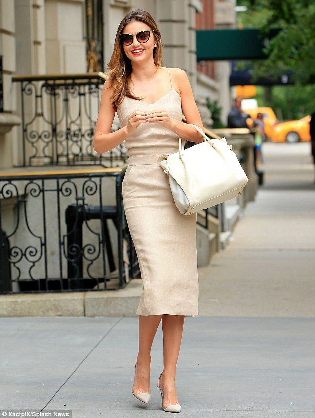 Uptown girl: Miranda Kerr was he height of class in a fitted beige dress in New York City http://dailym.ai/1r4LRPP