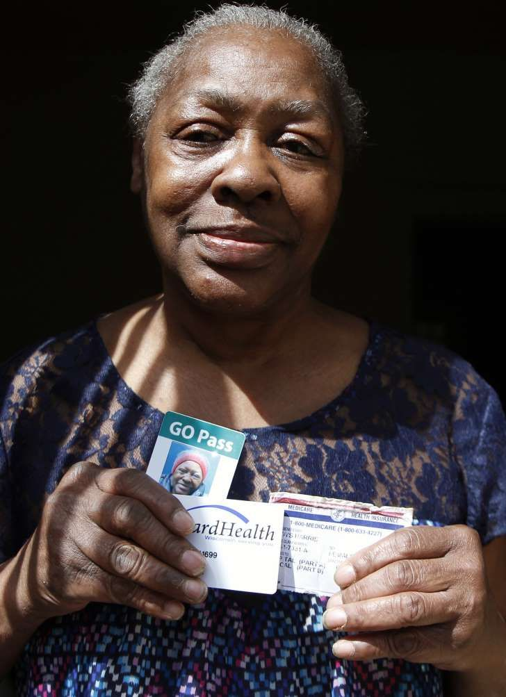 In this Monday, April 24, 2017 photo, Gladys Harris of Milwaukee holds some of the forms of identification she brought with her to the polls in the 2016 presidential election. She was unable to vote because she had lost her driver's license a few days before and thought one of the many other cards she had with her would work. She was given a provisional ballot but was unable to return with a proper ID in time. It was the first presidential election to be held under a new state law requiring…