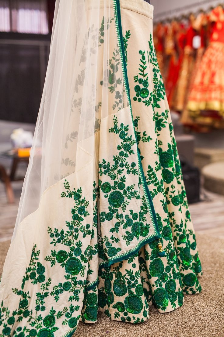 Beautiful intricate embroidery details from a stunning off white #lehenga with emerald green zardozi embroidery! How stunning does the emerald green look against the off white?