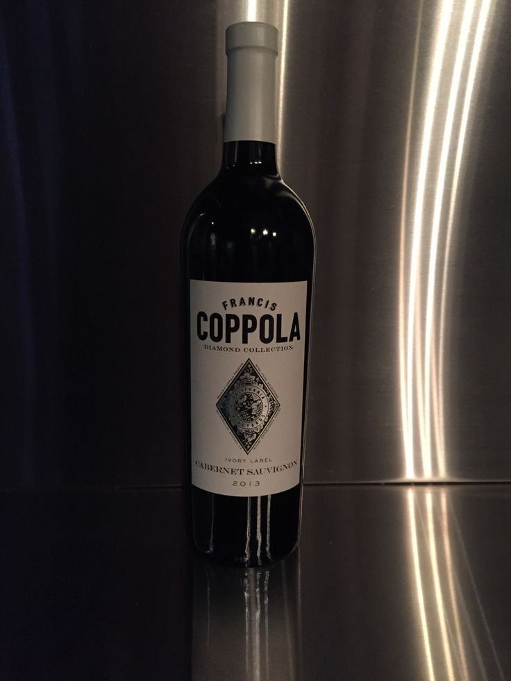 A great bottle of Francis Coppola's 2013 Cab. Nibble with garlicky Italian salami, pickled Calabrese eggplant I made in the summer and great Parm.