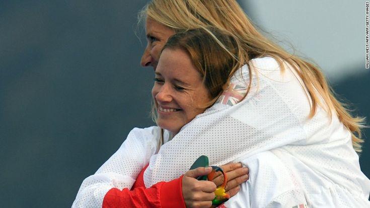 Gold medallists Britain's Hannah Mills and Saskia Clark celebrate on the…