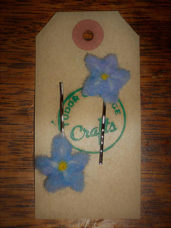 Check out this item in my Etsy shop https://www.etsy.com/uk/listing/511494172/a-pair-of-felted-forget-me-nots-hair