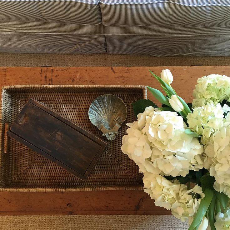 Can't handle this install... Definitely a coastal retreat! • . . . . . . . . #coastal #install #rusticrooster #interiordesign #coffeetable #tvroom #hydrangea #tulips #pine #love #tvroom #custom