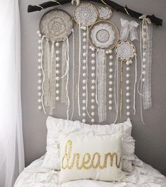 """Jenna on Instagram: """"Skyler and I made some quick doily dream catchers and put them on her pompom branch today. She had fun adding all the lace and different ribbons in, and I love that she did so much work on it. It makes it more hers. She saw a dream catcher wall like this when she was looking at Pinterest and wanted one similar! Dream pillow is from Sarah Kirkland ❤️"""""""