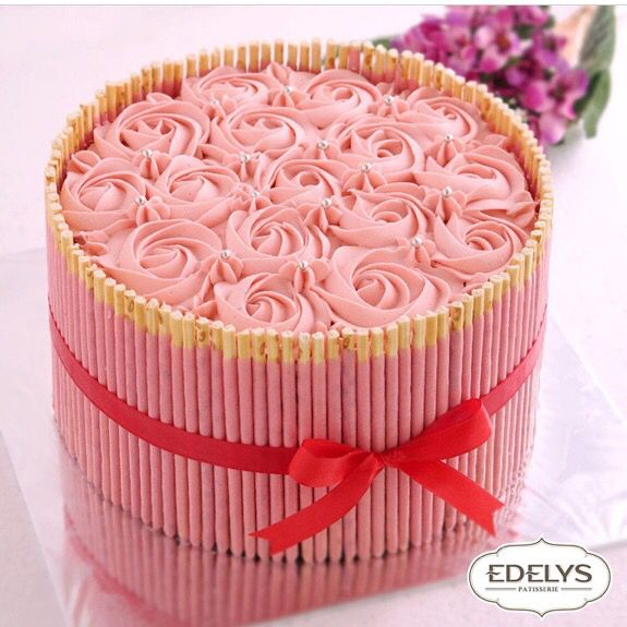 Pink rosette strawberry pocky cake by @edelyspatisserie. Location: Jakarta (Valentines Sweets Strawberry Roses)