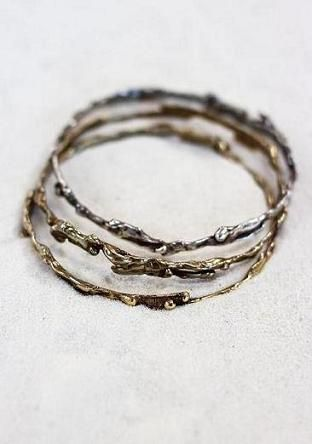 Thin stack-able bangles formed after lava. Available with or without stones  and in brass or sterling silver. When you order it with stones you get 5,  an assortment of garnet, citrine and sapphire.