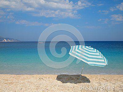 Beach umbrella on Beach of Myrtos, Kefalonia Island, Greece.