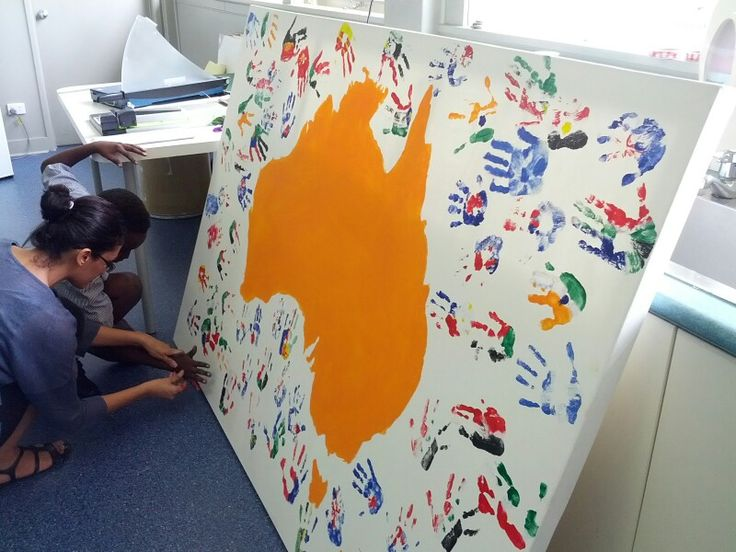 Harmony Day 21st March. Painting the childrens's hand prints different cultural flags from around the world