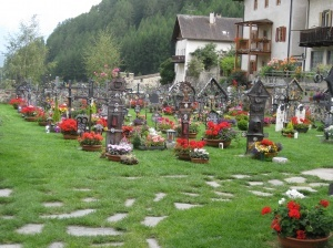 Karthaus, Sud Tirol, Italy  At this cemetery in the mountains every grave always has fresh flowers and most of them have a small light as well. So much love and care.