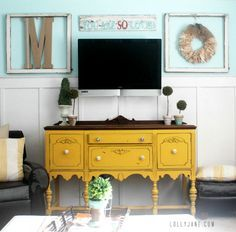 how-to-decorate-around-a-tv. I like the frame around the wreath too