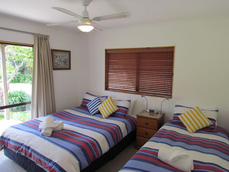 Side bedroom with Queen and Single bed. Ranch slider opens to verandah