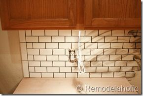 Use cheese cloth to wipe excess grout off of tile (cheese cloth was used on the left, a sponge on the right)
