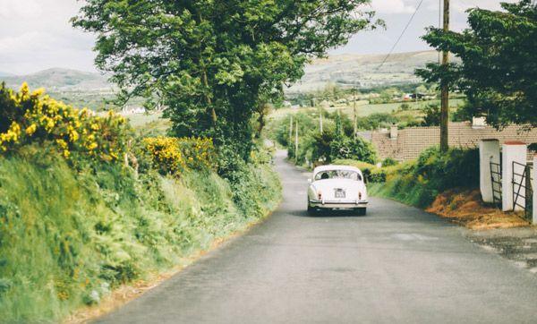 white vintage wedding car