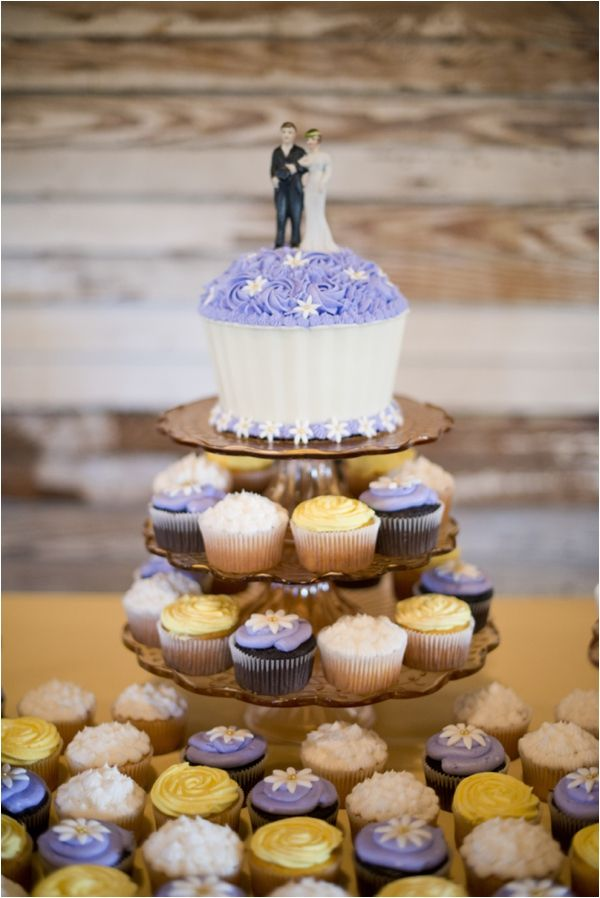 Cupcakes for guests, big cupcake for the bride and groom --- top layer to save for 1 year