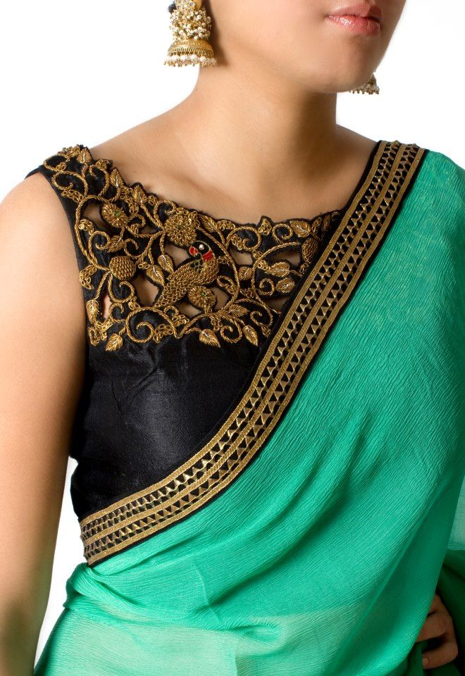 Green color chiffon saree designed with gota work hand embroidery border around the saree and the black color raw silk blouse designed with cut and zardosi work peacocks around the neck with sleeveless classy blouse design.