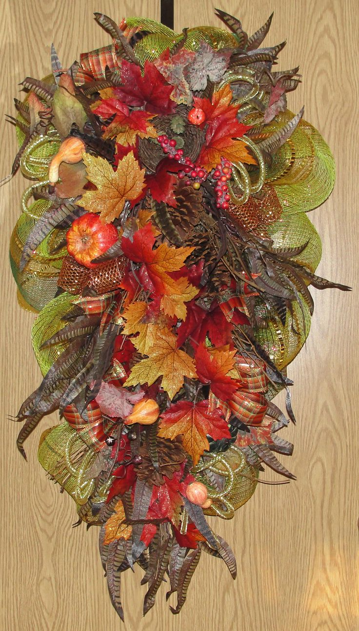 Vibrant fall deco mesh swag with silk feathers, autumn leaves, pumpkin, squash, berries, pinecones, and fall ribbon.