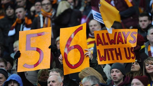 Bradford City fans pay tribute to the 56 supporters who died in the fire disaster at Valley Parade.