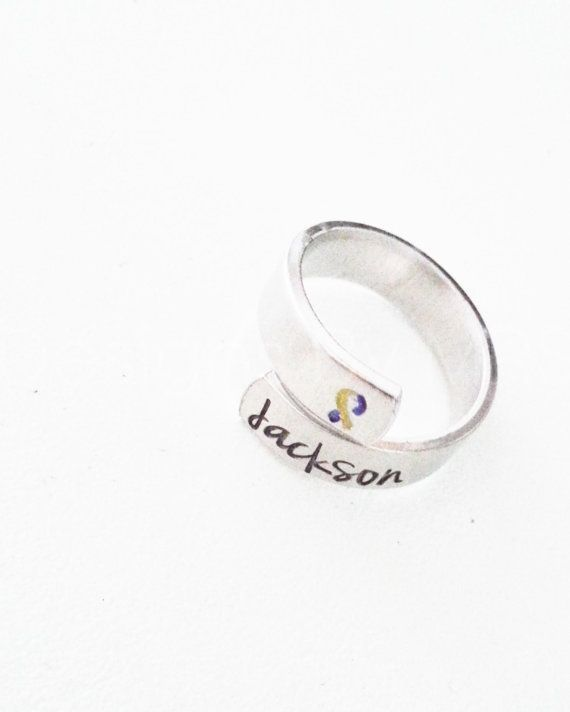This aluminum adjustable wrap ring is hand stamped with your child's name in the font of your preference. $12
