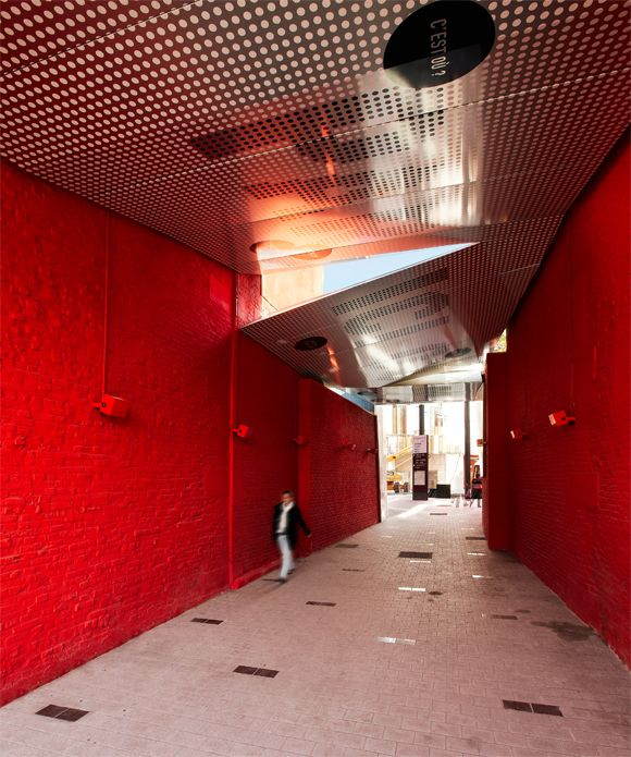 Atelier 9.81 pedestrian passageway project between two red residential buildings. Find more images at http://www.atelier981.org/atelier-architecture/passage-pieton-a-tourcoing.html.