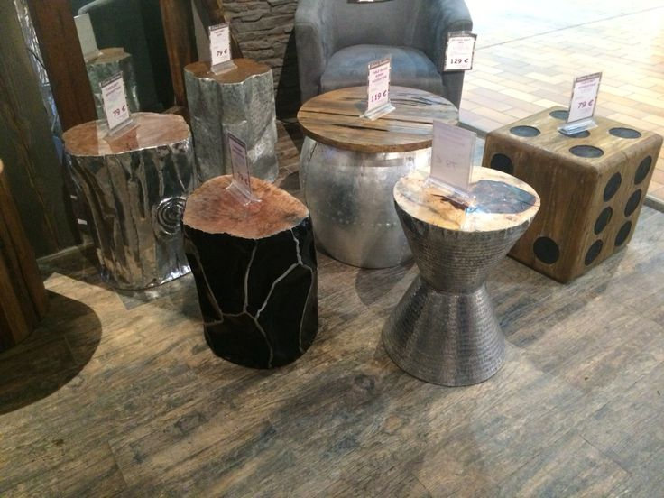 These tables combine wood and metal. I found these from Coctail Scandinave in Chamonix.