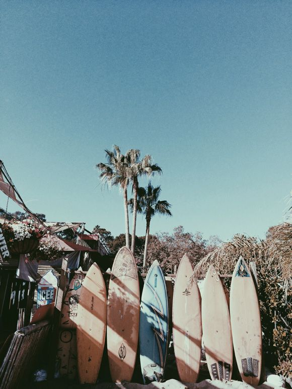 Our Inspiration: The cool coastal charm of this vintage, surfboard scene. Image via: Free People.