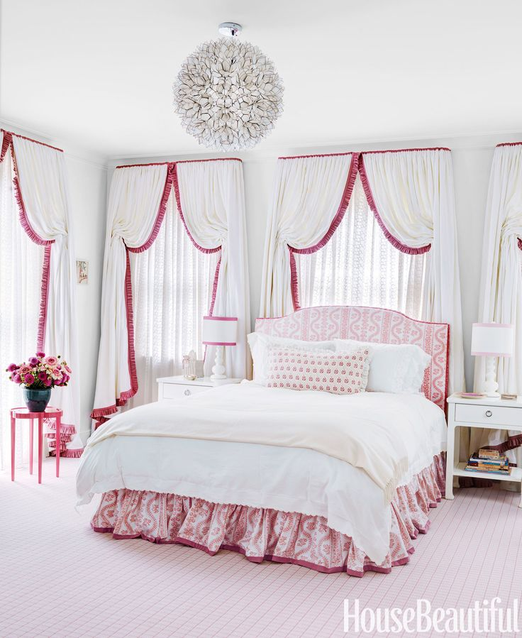 A former sleeping porch became a daughter's bedroom in a Nashville house. Designer Markham Roberts hid blackout shades behind eyelet sheers on the three walls of windows, then added linen curtains trimmed in Lee Jofa's Portofino. Headboard and bed skirt in Sister Parish Design's Dolly, through John Rosselli & Associates.   - HouseBeautiful.com