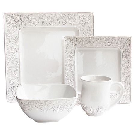 An understated stage for your culinary creations, this eye-catching earthenware dinner set showcases a floral-inspired trim in crisp white. ...