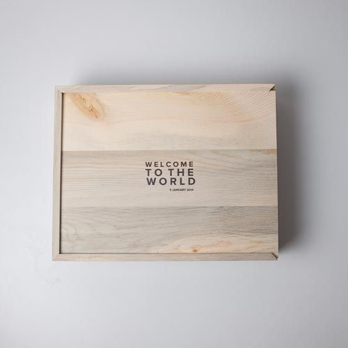 [The perfect home for your photo books or prints. Our wooden box features a customizable printed lid with your choice of text or an image. Best part? The box is handcrafted with beetle pine reclaimed our Colorado forests.]