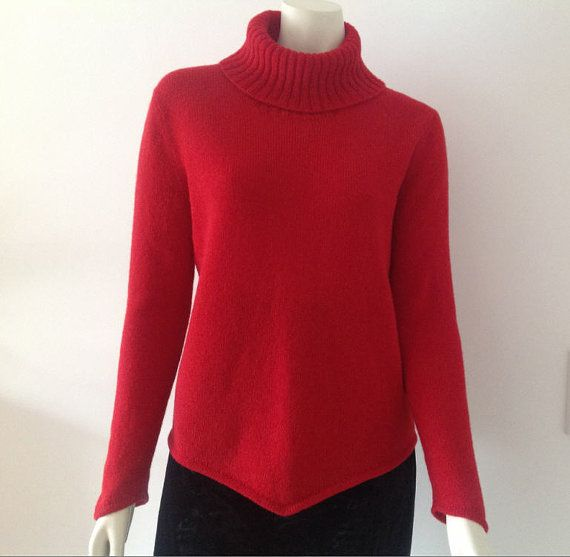 Red machine knitted Shetland wool turtleneck sweater. The sweater is pointed at front and back as well on the sleeves. The collar is a high turtleneck.
