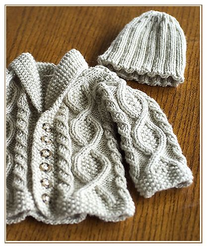 Cable sweater for baby.