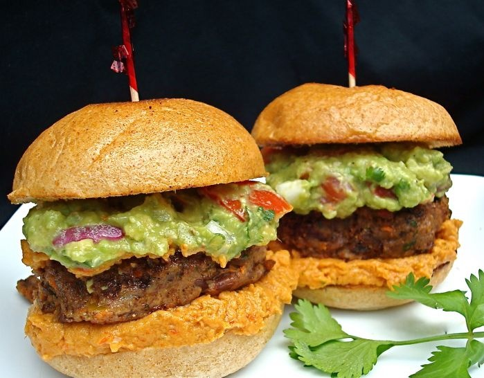 """""""mexicali"""" black bean burgers with mango sauce and guacamole, served with cajun-spiced sweet potato fries. NOM"""