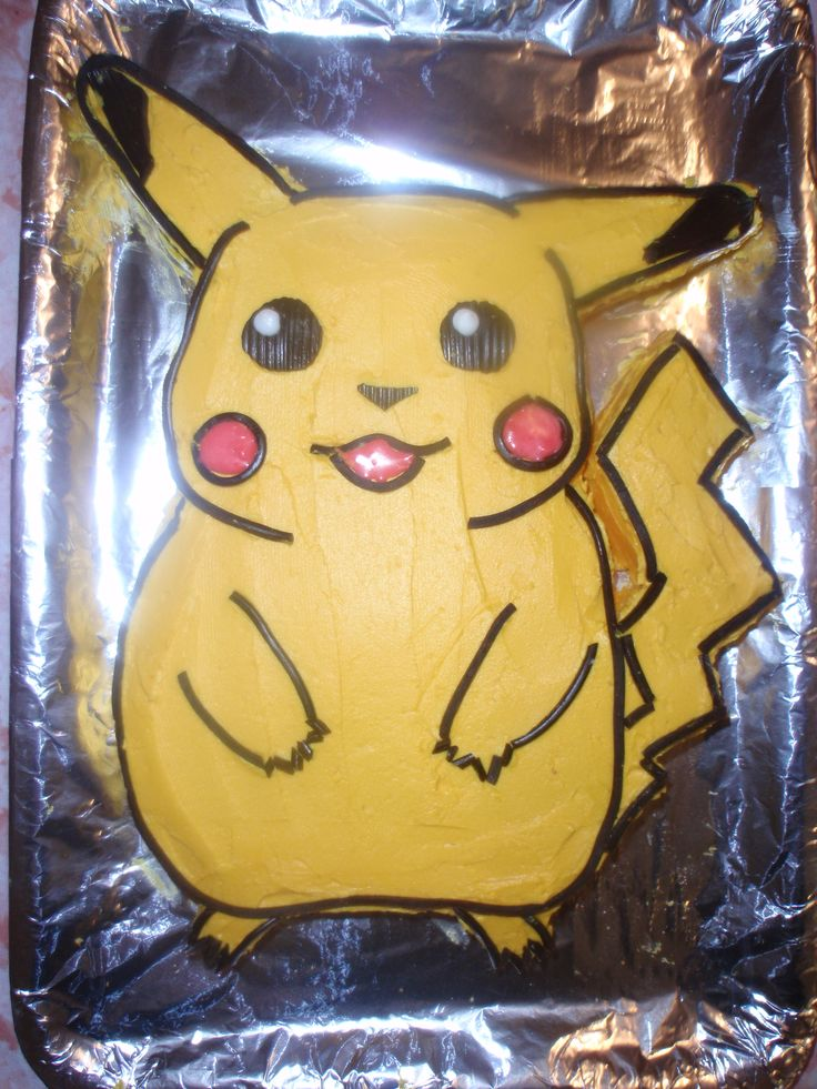 Pikachu :) Vanilla cake, used thin black licorice to outline him