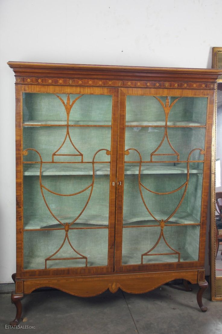Online bidding available! George III inlaid mahogany cabinet on later base, late 18th century, previously the upper case of a secretary bookcase, piece of glass is broken Condition: Good Size: 65.5x54x14.25 Appraised value:...