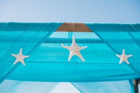 Wedding canopy with turquoise drapes & starfish decoration by Moments www.weddingincrete.com