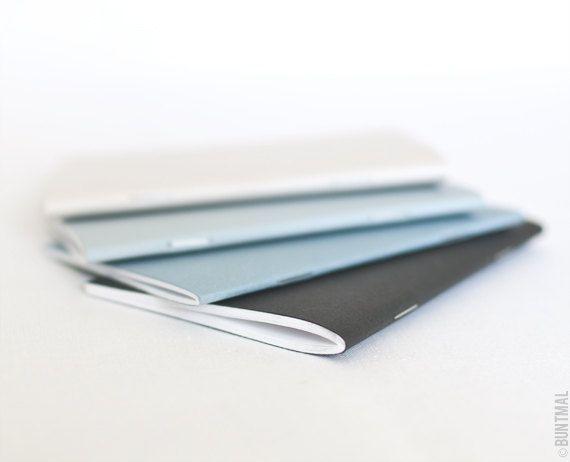 Pastel set of beige blue and black handmade notebooks by Buntmal, $14.00