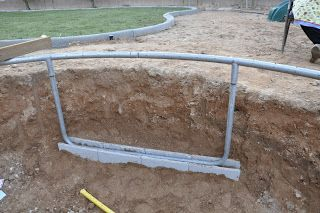 DIY Inground Trampoline Instructions.  We'll use the cinderblock idea to keep it level.