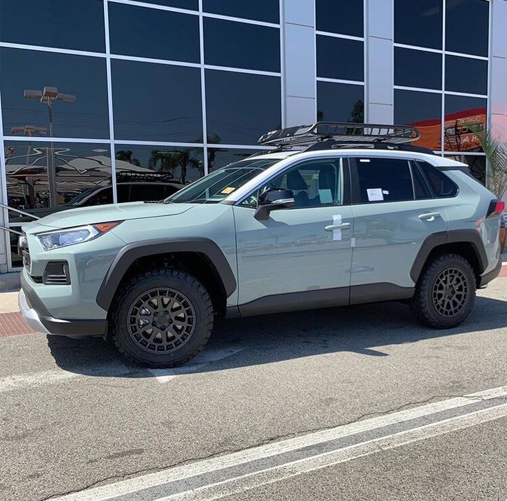 "2019 2 tone Toyota RAV4 with 17"" wheels and roof rack"