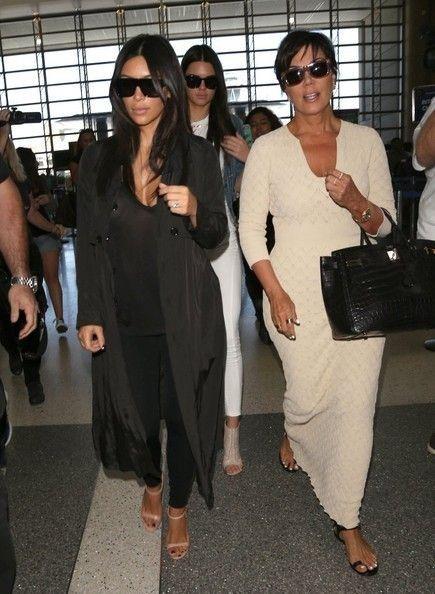 Kim Kardashian Photos: The Kardashian Clan Catches a Flight - Kim Kardashian Style