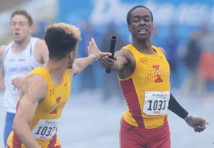 Iowa State's Ben Kelly exchanges baton with Elijah Young during university men's 4x400 meter relay in the Drake Relays, at Drake Stadium Friday, April 28, 2017, in Des Moines, Iowa. Photo by Nirmalendu Majumdar/Ames Tribune http://www.amestrib.com/sports/drake-relays-isu-s-luque-takes-second-long-jump