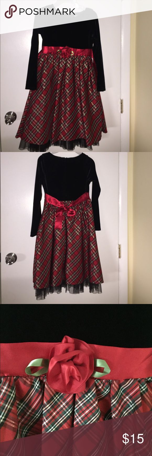Dollie&Mr dress for special occasions! Long sleeved dress. Above waist is black velvet. Has a ribbon belt with a rose. Below waist is plaid. ONLY WORN FOR A HOUR! In great condition Dresses