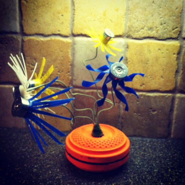 A center piece for a trap shooting banquet, the flowers are cut shotgun shells