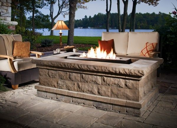 Outdoor fire pit with a beautiful lake view. #NottinghamElements
